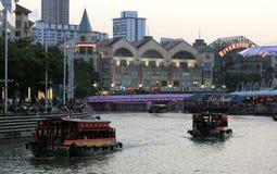 Boat Cruise. Singapore - June 2016 Boats cruising down Singapore River near Clarke Quay royalty free stock photography