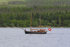 Boat Cruising. A lone boat cruising on Lake Loch Ness in Inverness, Scotland royalty free stock images