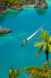 Boat Cruising Around small green Islands belonging Royalty Free Stock Image