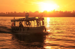 Boat cruising the Nile river at sunset, Luxor Royalty Free Stock Images