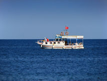 Boat cruising on sea. Boat cruising in Black Sea off Sinop coast Turkey Royalty Free Stock Photography