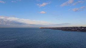 Boat cruising Sydney east coast stock footage