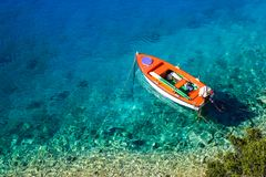 Boat on crystal clear water stock photo