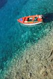 Boat on crystal clear water royalty free stock images