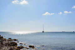 Boat on crystal sea. Boat on Meditarien Sea - view from Golden Bay (beach), sunny day and crystal sea Royalty Free Stock Photography