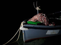 Boat in darkness. Fishing boat with heap of nets on it, somewhere in the darkness royalty free stock photos