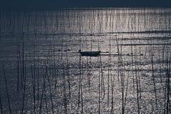 Boat in dawn Stock Photos