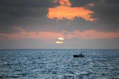 Boat at dawn Stock Images