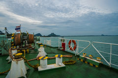 Boat deck with anchors rope and life buoy Royalty Free Stock Photography