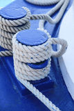 Boat deck with rope. A blue painted boat deck of an old fishing Trawler with tied ropes Royalty Free Stock Photos
