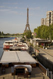 Boat decks and the Eiffel Tower, Paris. Eiffel Tower on the banks on the River Seine, Paris, France with cruise boat decks in the foreground Stock Photo