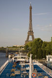 Boat decks and the Eiffel Tower, Paris. Eiffel Tower on the banks on the River Seine, Paris, France with blue cruise boat decks in the foreground Royalty Free Stock Photo