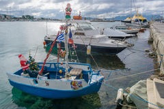 Boat decorated for Christmas in the port of Aegina, Greece. Royalty Free Stock Image