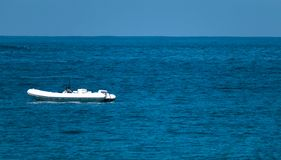 Boat on the deep sea royalty free stock image