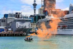 A boat demonstrating an orange marine flare in Auckland Harbour, New Zealand stock photo