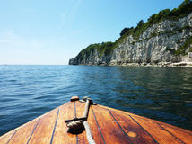 Boat and Devon Cliffs Stock Photography