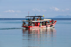 Boat with divers swim to the coral reef for diving. Island Koh Phangan, Thailand Royalty Free Stock Images