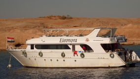 The boat with diving equipment. Sharm el Sheikh, Egypt - January 8, 2017: The boat with diving equipment. Against the background of the desert coastline stock video