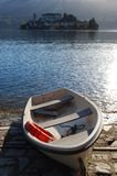 Boat on the dock. At Orta lake, St. Giulio island in background, Piedmont, Italy Royalty Free Stock Image