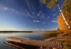 Boat dock and autumn trees. Along a Saskatchewan Lake Royalty Free Stock Images