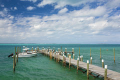 Boat and dock in Bahamas Royalty Free Stock Photos