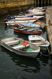 Boat Dock. Bar Harbor, Maine, USA - September 24, 2013: Multiple fishing boats tied to a Bar Harbor boat dock and floating in dingy water royalty free stock photo