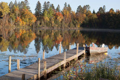 Boat dock and boat in the fall Royalty Free Stock Photography