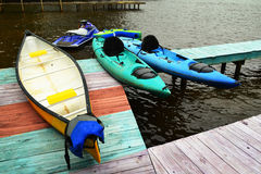 Boat Dock with Canoe and Kayaks Stock Photos
