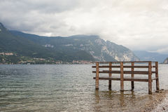Boat dock on Como lake in Italy Royalty Free Stock Photo