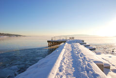 Boat dock covered with snow and ice Royalty Free Stock Image