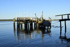 Boat dock damaged by Hurricane Matthew, Vilano Beach, Florida. Damage to private boat dock in blue waters in aftermath of Hurricane Matthew in Vilano Beach Stock Photography