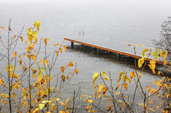 Boat dock on foggy day. Stock Image