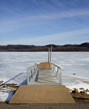 Boat dock on a frozen lake Royalty Free Stock Photography