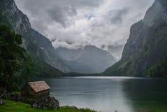 Boat dock hangar on Obersee mountain lake in Alps.  Bavaria, Ger Stock Photos