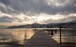 Boat Dock on Lake Okanagan. An image of a moody sunset on Lake Okanagan in BC, canada Royalty Free Stock Photo