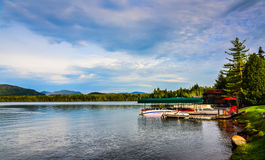 Boat Dock on Lake Placid. Green awning covered boat dock on Lake Placid at the Adirondack Mountains in Upstate New York Stock Images