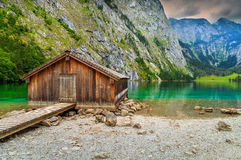 Boat dock on Obersee alpine lake,Berchtesgaden,Bavaria,Germany,Europe. Wooden boathouse on the mountain lake in Bavarian Alps,Obersee,Berchtesgaden,Germany Stock Photography