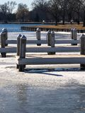Boat dock in park with icy water Stock Image