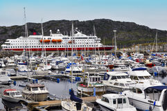 Boat dock and pier for ships. A huge number of small and large yachts and boats tied at the pier and a large ferry  moored there. On background there are Royalty Free Stock Photography