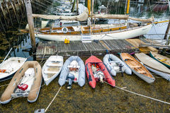 Boat Dock with Sailboats and Dinghies Royalty Free Stock Photo