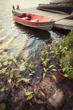 Boat at dock on small lake Royalty Free Stock Photography