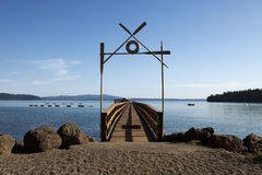 Boat Dock At Summer Camp. A long dock at summer camp is used for boating as well as open water swimming Stock Images
