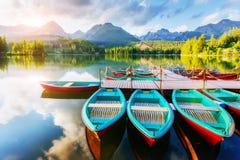 Boat on the dock surrounded mountains. Fantastic Shtrbske Pleso High Tatras. Slovakia Stock Image