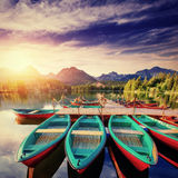 Boat on the dock surrounded mountains. Fantastic Shtrbske Pleso. High Tatras. Slovakia, Europe Stock Photo