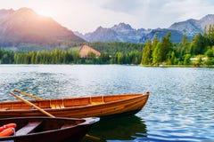 Boat on the dock surrounded mountains. Fantastic Shtrbske Pleso High Tatras. Slovakia royalty free stock image
