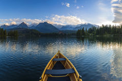 Boat on the dock surrounded mountains royalty free stock image