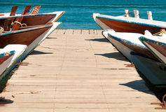 Boat dock, wooden landing stage. Royalty Free Stock Images