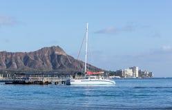 Boat docked by Diamond Head Waikiki Hawaii Royalty Free Stock Photo