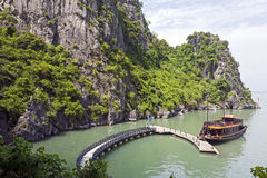 Boat Docked in HaLong Bay. A tourist junk is docked at the small wharf at Sung Sot caves in HaLong Bay in northern Vietnam royalty free stock photo