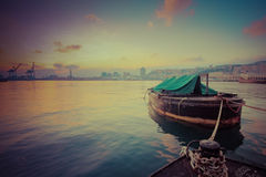 Boat docked in harbor sunset time. Royalty Free Stock Images